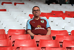 A Burnley fan in the stands before the Premier League match at Anfield, Liverpool.