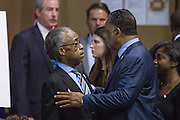Rev. Jesse Jackson greets Rev. Al Sharpton (left) before the start of funeral services for slain State Senator Clementa Pinckney at the TD Arena June 24, 2015 in Charleston, South Carolina. Pinckney is one of the nine people killed in last weeks Charleston church massacre.