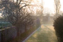 The Moat Walk on a misty morning at Sissinghurst Castle Garden