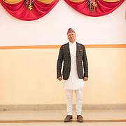 The groom's father. A wedding participant poses for a portrait during the reception.
