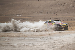 AREQUIPA, Jan. 11, 2019  French driver Sebastien Loeb and Monaco co-driver Daniel Elena compete during the 4th stage of the 2019 Dakar Rally Race, near La Joya, Arequipa province, Peru, on Jan. 10, 2019. Sebastien Loeb and Daniel Elena finished the 4th stage with 3 hours 51 minutes and 12 seconds. (Credit Image: © Xinhua via ZUMA Wire)