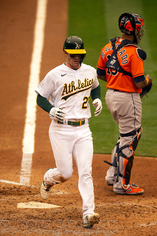 Sep 10, 2020; Oakland, California, USA; Oakland Athletics Mark Canha (20) scores from second base on a single by Chad Pinder while Houston Astros catcher Martín Maldonado (15) awaits the relay during the seventh inning of a baseball game at Oakland Coliseum. Mandatory Credit: D. Ross Cameron-USA TODAY Sports