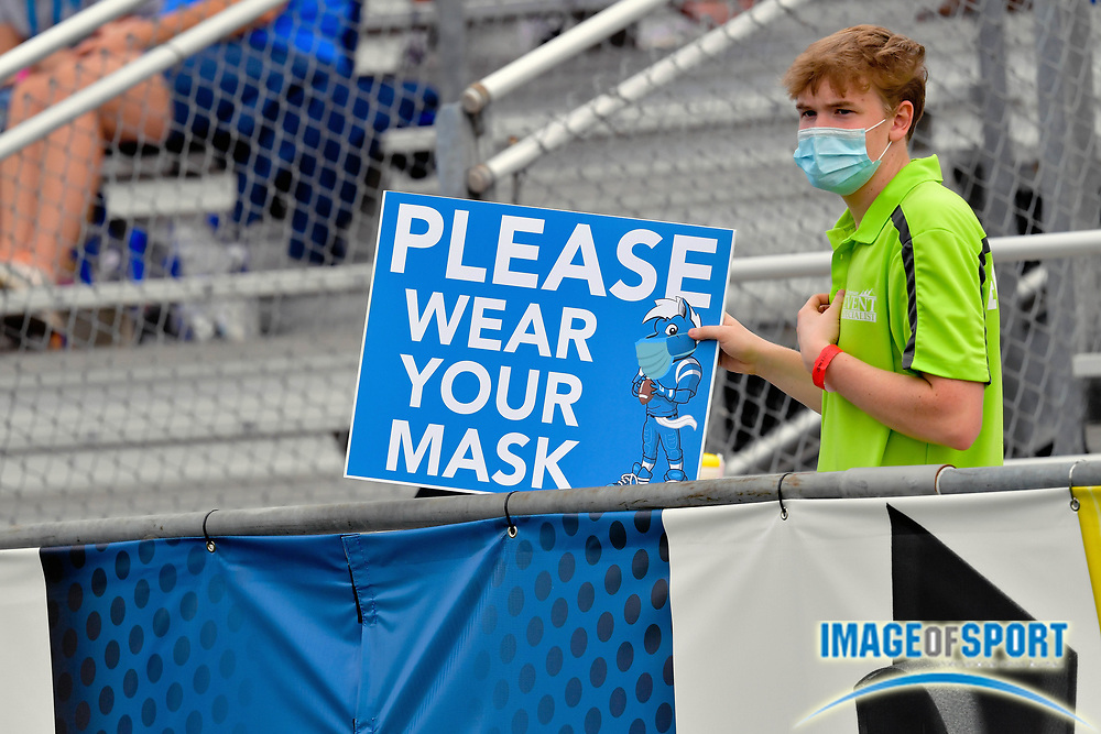 """An event staff employee holds a sign reminding fans to be responsible during the first half between the Middle Tennessee Blue Raiders and the Troy Trojans at Johnny """"Red"""" Floyd Stadium in Murfreesboro, Tenn., Saturday, Sept. 19, 2020. (Jim Brown/Image of Sport)"""