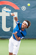 Cypress' Marcos Baghdatis hits a serve to USA's John Isner during their men's quarterfinals singles match at the Citi Open ATP tennis tournament in Washington, DC, USA, 2 Aug 2013. Isner won the match 6-7, 6-4, 6-4 to advance to the semifinals on Saturday.