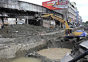KAOHSIUNG, CHINA - AUGUST 04: (CHINA OUT) <br /> <br /> Gas Explosion Rips up entire road in china<br /> <br /> An excavator clears soil and stone pile after Kaohsiung\'s gas explosion on August 4, 2014 in Kaohsiung, Taiwam of China. Part of the pipeline was found wornout after 4 days of investigations. <br /> ©Exclusivepix