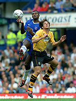 Marcel Desailly (Chelsea) Matt Jansen (Blackburn). Chelsea v Blackburn Rovers. 30/8/03. Credit : Colorsport/Andrew Cowie.