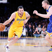 11 April 2014: Los Angeles Lakers guard Jordan Farmar (1) drives past Golden State Warriors guard Steve Blake (25) during the Golden State Warriors 112-95 victory over the Los Angeles Lakers at the Staples Center, Los Angeles, California, USA.