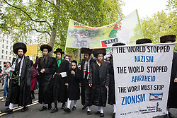 London, UK. 22nd May, 2021. Ultra-Orthodox anti-Zionist Haredi Jews from Neturei Karta UK take part in the National Demonstration for Palestine. It was organised by pro-Palestinian solidarity groups in protest against Israel's recent attacks on Gaza, its incursions at the Al-Aqsa mosque and its attempts to forcibly displace Palestinian families from the Sheikh Jarrah neighbourhood of East Jerusalem.