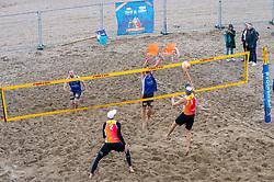 Erik van der Schaaf & Sam Gortzak vs. Robert Meeuwsen & Alexander Brouwer in action. The DELA NK Beach volleyball for men and women will be played in The Hague Beach Stadium on the beach of Scheveningen on 22 July 2020 in Zaandam.