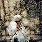 Man sitting by Saint George's Church, Lalibela, Ethiopia.