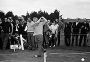19/08/1967<br /> 08/19/1967<br /> 19 August 1967<br /> Irish Dunlop £1,000 Tournament at Tramore Golf Club, Co. Waterford. Christy O'Connor watches A. Skerritt (Waterford) driving off at the 17th hole.