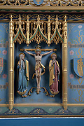 Interior of the priory church at Edington, Wiltshire, England, UK - altar reredos detail Christ on the Cross