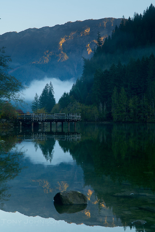 low clouds hug the treetops along the Thunder Arm of Diablo Lake as seen from Colonial Creek campground
