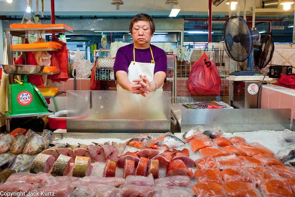 """Apr. 28 -- SINGAPORE:  A fish monger in the """"wet"""" market in Chinatown in Singapore.   PHOTO BY JACK KURTZ"""
