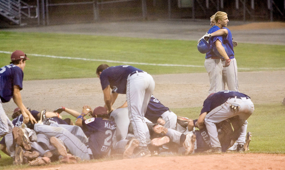 MIDDLETOWN, CT - 09 AUGUST 2010 -.East Longmeadow Post 293's Frank Calabrese and teammate James Christensen hug after losing Monday's American Legion Northeast Regional Tournament Championship game to Branford Post 83 at Palmer Field in Middletown. East Longmeadow lost, 2-1..Photo by Josalee Thrift