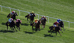 Muntahaa ridden by jockey Jim Crowley (top right) on their way to winning the Dubai Duty Free Finest Surprise Stakes during day two of the Dubai Duty Free Spring Trials & Beer Festival at Newbury Racecourse.