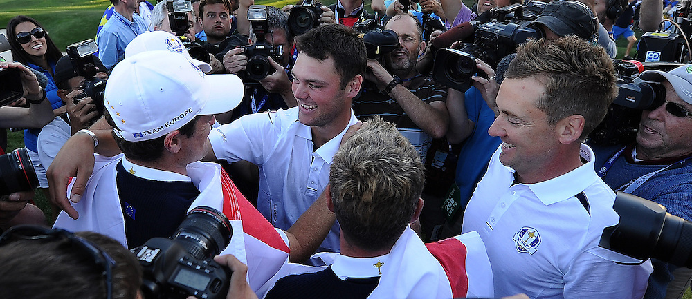 Martin KAYMER (GER) with Justin ROSE (ENG) and Ian POULTER (ENG) during final day Singles victory celebrations,Ryder Cup Matches,Medinah CC,<br /> Medinah,Illinois,USA.