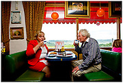A couple enjoying tea and toast at the Newcott Chef. Shot for Roadside Britain