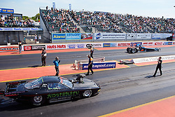 © Licensed to London News Pictures.  26/05/2013. PODINGTON, UK. Dragsters compete in round 1 of FIA European Drag Racing Championship at the Santa Pod Raceway in Podington. Over 10,000 motorsports fans enjoy blue skies to watch the cars travel a quarter mile course in under 5 seconds reaching speeds of 300 miles an hour. Photo credit: Cliff Hide/LNP