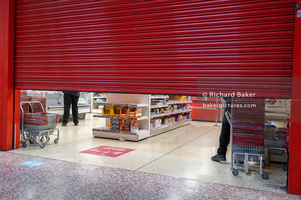 On the day that Elephant & Castle Shopping Centre closes before its demolition and redevelopment, the shutters come down in Iceland as the mall locks its doors for the final time after 55 years, on 24th September 2020, in south London, England. The much-criticised architecture of the Elephant & Castle Shopping Centre was opened in 1965, built on the bomb damaged site of the former Elephant & Castle Estate, originally constructed in 1898. The centre was home to restaurants, clothing retailers, fast food businesses and clubs where south Londoners socialised and met lifelong partners.