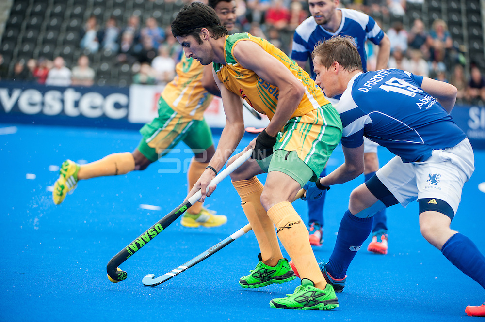 Miguel Da Grace (RSA) is tackled by David Forsyth (SCO). Scotland v South Africa, 3rd/4th play-off, Investec London Cup, Lee Valley Hockey & Tennis Centre, London, UK on 13 July 2014. Photo: Simon Parker