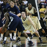 Central Florida guard A.J. Rompza (3) defends Bryan Beasley during a Conference USA NCAA basketball game between the Rice Owls and the Central Florida Knights at the UCF Arena on January 22, 2011 in Orlando, Florida. Rice won the game 57-50 and extended the Knights losing streak to 4 games.  (AP Photo/Alex Menendez)