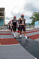 KELOWNA, BC - AUGUST 17:  Tyler GOING #20 and Kian ISHANI #8 of Okanagan Sun walk to the field against the Westshore Rebels at the Apple Bowl on August 17, 2019 in Kelowna, Canada. (Photo by Marissa Baecker/Shoot the Breeze)