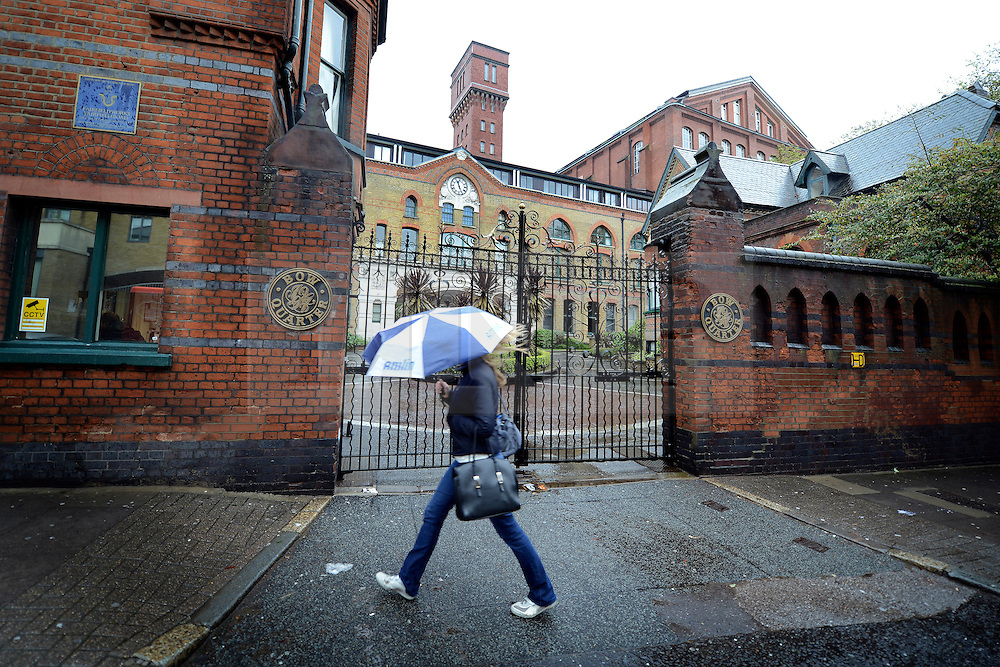 © Licensed to London News Pictures. 29/04/2012. London, UK . A woman walks past the gated community. The military has told residents of an upscale apartment development near the Olympic Park in east London it is installing a missile battery on top of a tower within their housing complex to defend the 2012 Games this summer. Photo credit : Stephen Simpson/LNP