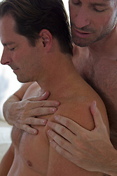 man giving another man a massage