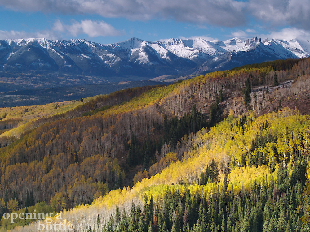 The first snow of the year settles on The Castles, the West Elk Mountains and aspens on Ohio Pass just west of Crested Butte, Colorado.