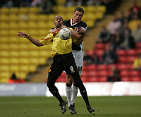 Photo: Lee Earle.<br /> Watford v Hull. Coca Cola Championship. 30/04/2006. Hull's Damien Delaney (R) holds off Marlon King.