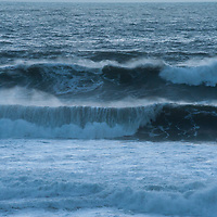 Surf waves roll ashore from the Pacific Ocean at Gray Whale Cove State Beach near Montara, California.