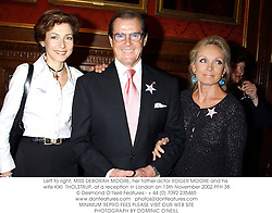 Left to right, MISS DEBORAH MOORE, her father actor ROGER MOORE and his wife KIKI  THOLSTRUP, at a reception in London on 13th November 2002.PFH 38