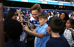 2 September 2017 - Charity Football - Game 4 Grenfell - Olly Murs takes a photo with a young fan ; others look on in awe - Photo: Charlotte Wilson