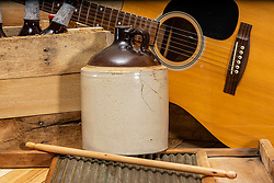 Jug Band studio art.  This jug band consists of a moonshine crock jug, a 6 string acoustical guitar, a washboard and drummers stick and a few brewskis for good measure.