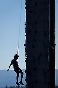 Chris Wang, 10, of Fremont repels down a rock climbing wall during Santa Clara County Parks Day on the Bay event at Alviso Marina County Park in Alviso, California, on October 13, 2013. (Stan Olszewski/SOSKIphoto)