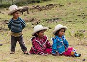 Cute campesino children with hats at Pishgopampa village in Jancapampa Valley. Day 4 of 10 days trekking around Alpamayo, in Huascaran National Park, Cordillera Blanca, Andes Mountains, Peru, South America.