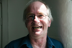 Portrait of a older man laughing,