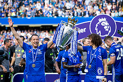 Retiring captain John Terry and David Luiz lift the trophy as Chelsea celebrate winning the 2016/17 Premier League - Rogan Thomson/JMP - 21/05/2017 - FOOTBALL - Stamford Bridge - London, England - Chelsea v Sunderland - Premier League..