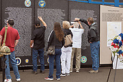 Guests at traveling Vietnam War Memorial wall at Warbirds Over the West.