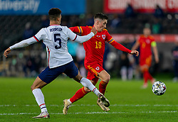 SWANSEA, WALES - Thursday, November 12, 2020: Wales' Harry Wilson gets past USA's Antonee Robinson during an International Friendly match between Wales and the USA at the Liberty Stadium. (Pic by David Rawcliffe/Propaganda)