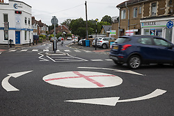 Windsor, UK. 10th July, 2021. A vehicle flying a small England flag passes a mini-roundabout painted with the St George's flag. The Royal Borough of Windsor and Maidenhead repainted several roundabouts for safety reasons previously daubed with England flags before England's Euro 2020 quarter-final match against Ukraine but it appears that local residents have restored them in advance of the Euro 2020 final between England and Italy. Credit: Mark Kerrison/Alamy Live News