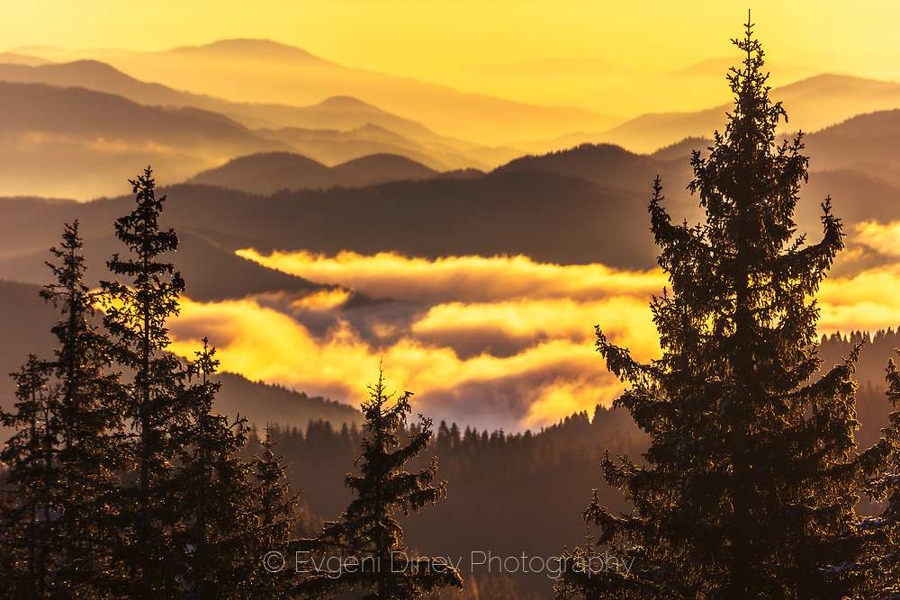 Clouds in the ridge of the mountain at sunrise