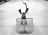 Goaltender J. S. Giguere celebrates the Ducks' 3-2 overtime victory against the New Jersey Devils in Game 3 of 2003 Stanley Cup Finals at the Arrowhead Pond.