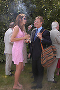Annabel Brooks and Robert Fox. Marriage of Emilia Fox to Jared Harris. St. Michael's and All Angels. Steeple. Nr. Wareham. Dorset. 16 July 2005. ONE TIME USE ONLY - DO NOT ARCHIVE  © Copyright Photograph by Dafydd Jones 66 Stockwell Park Rd. London SW9 0DA Tel 020 7733 0108 www.dafjones.com
