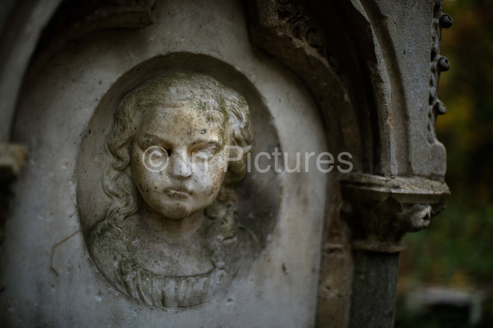 Gravestone for young girl in Stoke Newington Abney Park Cemetry, London UK. Abney Park cemetery is one of the Magnificent Seven cemeteries in London, England. <br /> By the early 1990s the cemetery was acknowledged to be the largest woodland ecosystem in North London, close to the centre of the City of London.