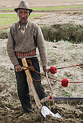 China, Tibet, portrait of man with decorated plough