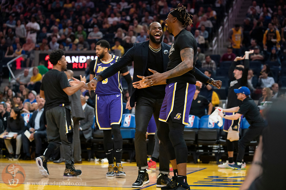 February 27, 2020; San Francisco, California, USA; Los Angeles Lakers forward LeBron James (23, left) and center Dwight Howard (39, right) celebrate during the third quarter against the Golden State Warriors at Chase Center.