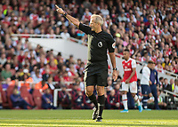 Football - 2019 / 2020 Premier League - Arsenal vs. Tottenham Hotspur<br /> <br /> Referee Martin Atkinson  points to the corner flag signalling his decision at The Emirates.<br /> <br /> COLORSPORT/DANIEL BEARHAM