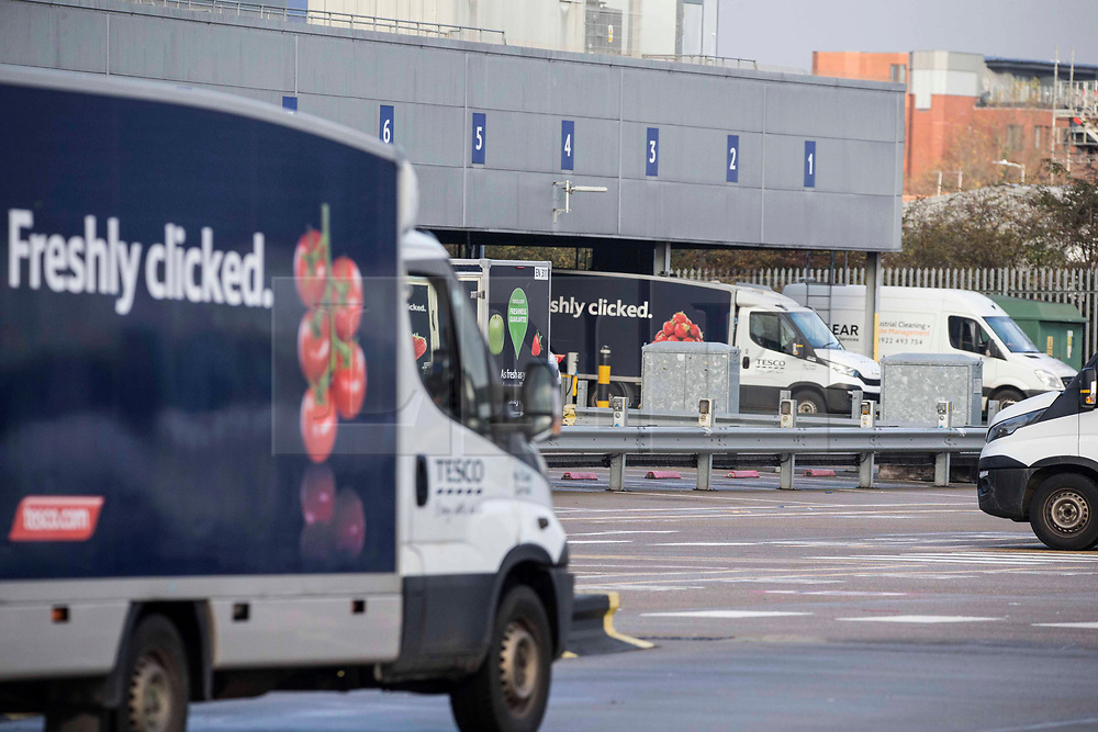© Licensed to London News Pictures. 10/11/2020. London, UK. Vans are getting ready to deliver groceries at Tesco warehouse  in Enfield, north London. Members of the public have been warned to book their Christmas delivery slots earlier, as the huge spike in demand could make stores struggling to keep up with deliveries. Photo credit: Marcin Nowak/LNP